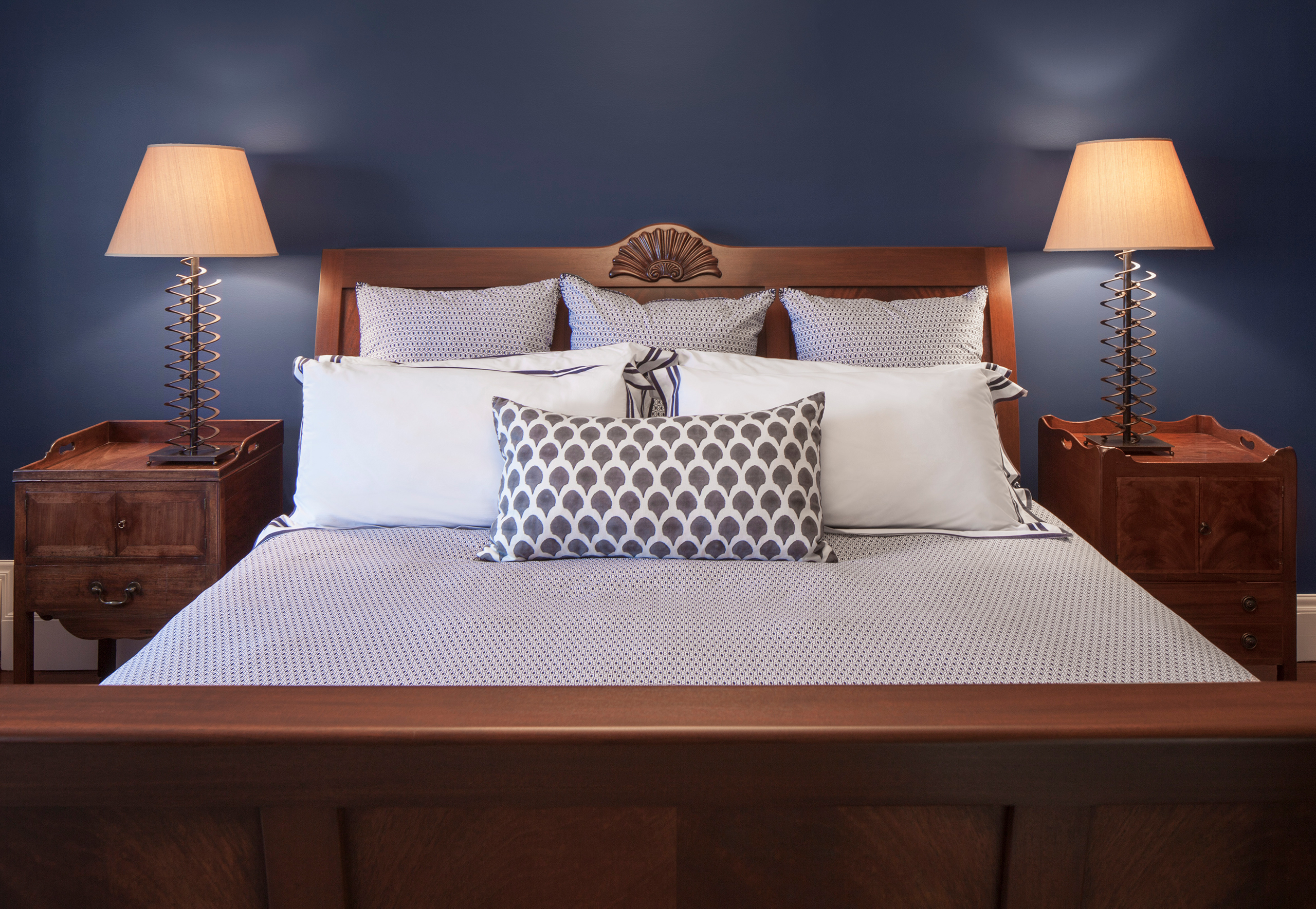 dark blue room with bed