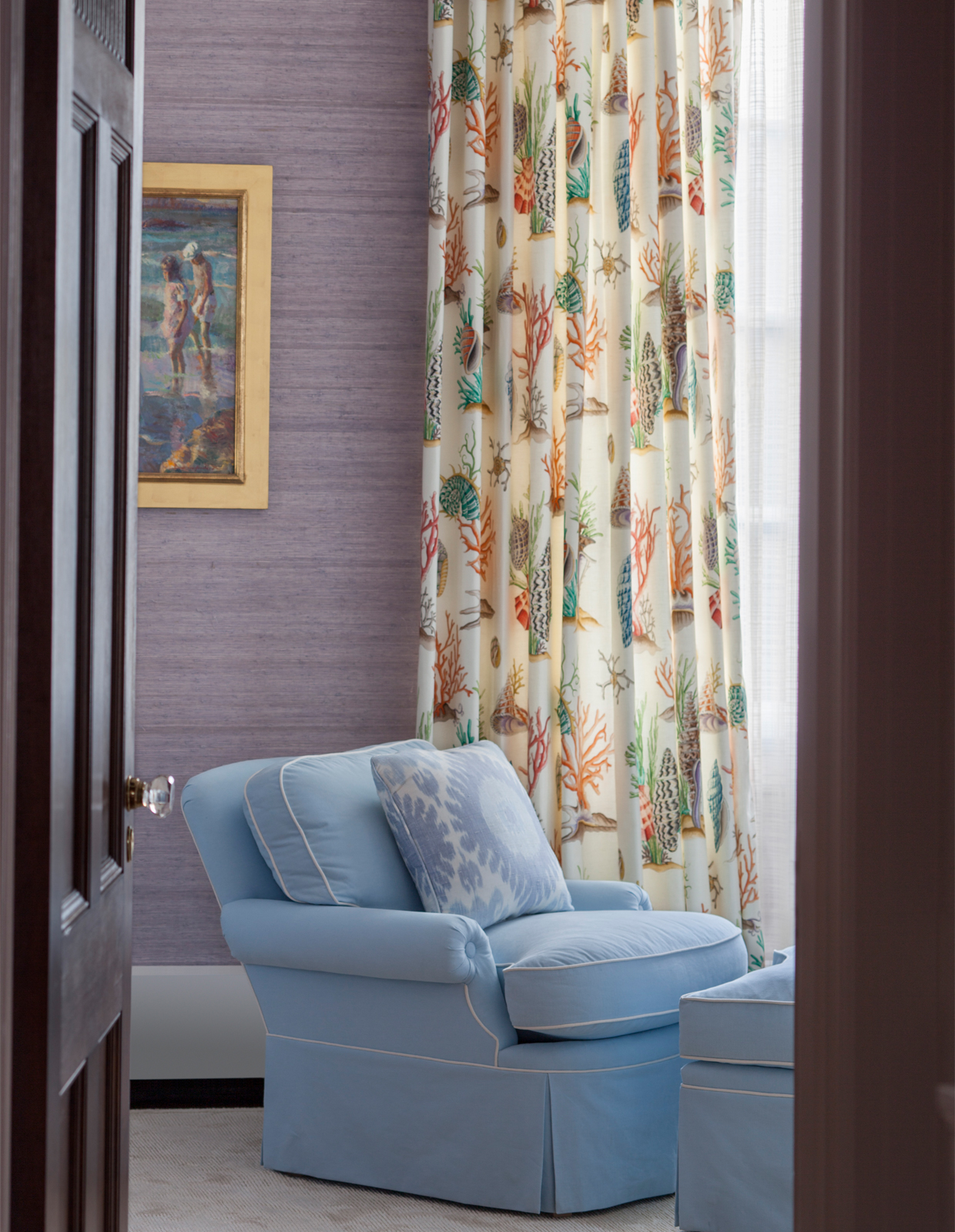 blue chair with curtains