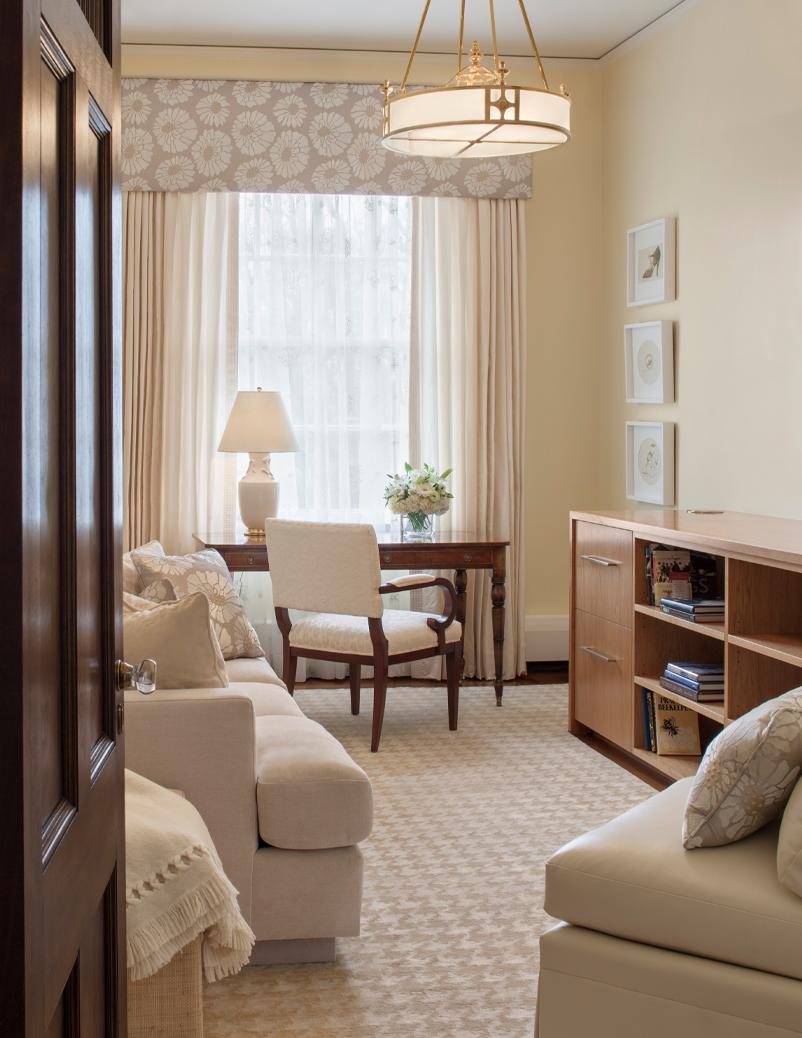 cream bedroom with desk