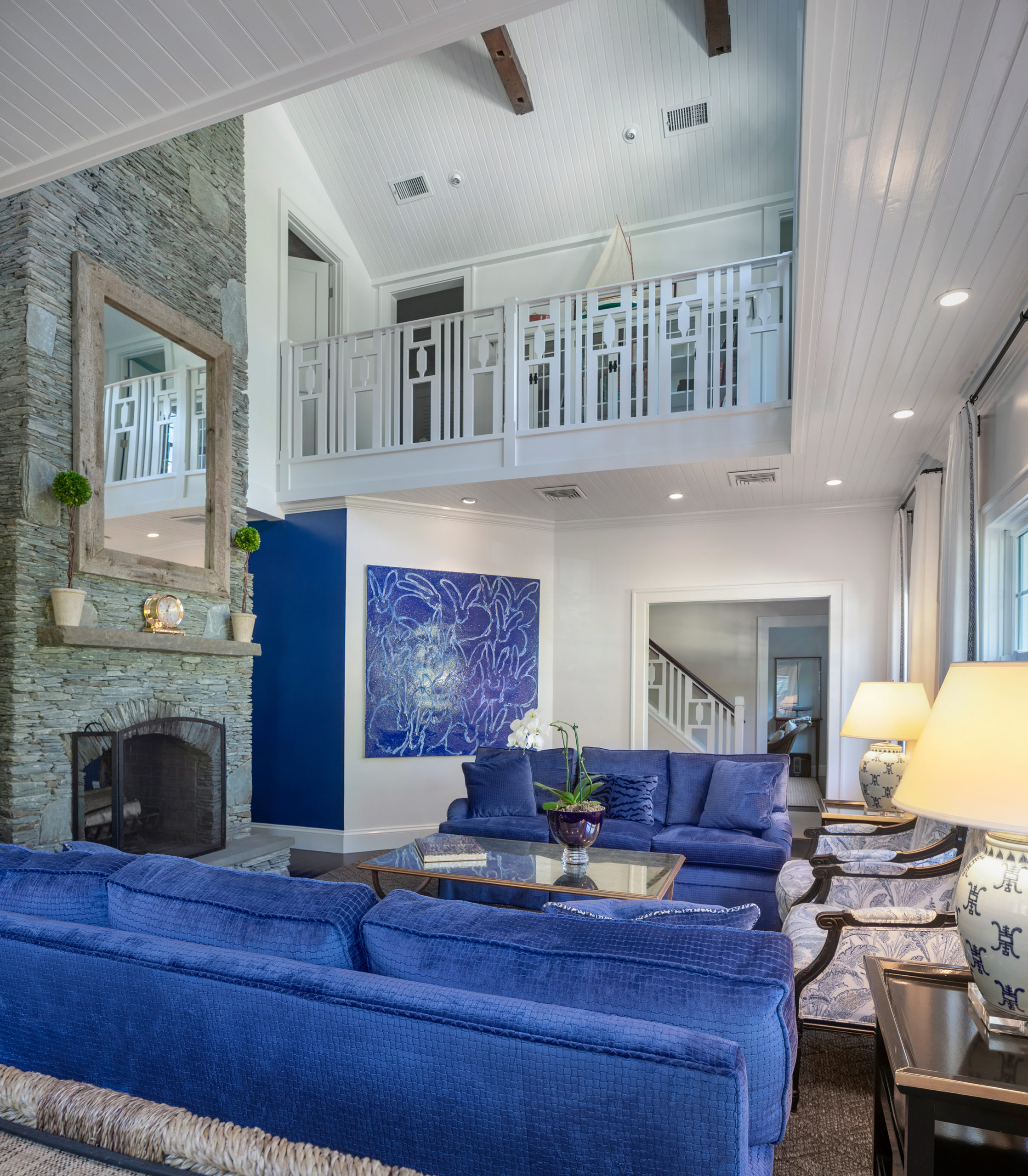 living room with blue couches
