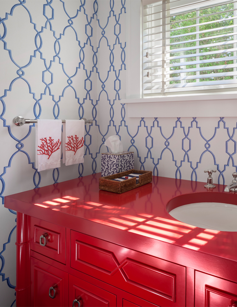 red bathroom with wallpaper